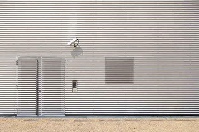 Security camera looking at the hidden door, representing what to look for in a commercial surveillance system