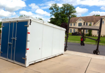 a portable storage unit is being delivered to a residence